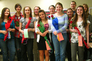 The new Spanish Honor Society inductees gather and recieve roses on March 9, 2011.