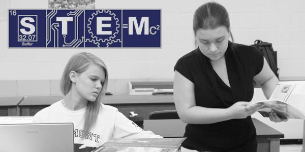 Seniors Emma Dornbush and Skye O'Beollain work on a project in Biotechnology, one of the STEM classes offered at Fairmont. (Photo: Stephanye Floyd)