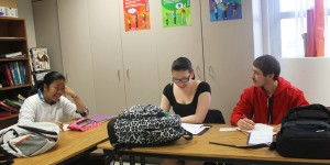 Three of Fairmont&#039;s ESOL (English as secord or other language) students, Pompan Mongkonist, Rebecca MacDonald, and Zaid Ismael converse during their class. Photo Credit: Jilly Hall