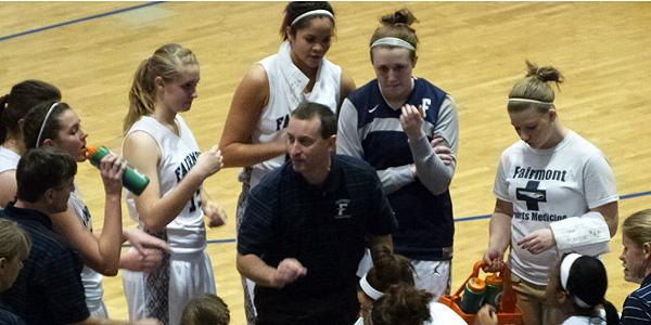 Head varsity coach Tim Cogan gives a pep talk to Fairmont's girls varsity basketball team. (Photo by: Rachel Sheidler)