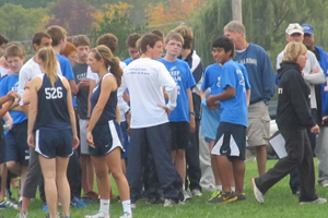 Fairmont's cross country team has a pep-talk prior to their races in the Springboro Invitational