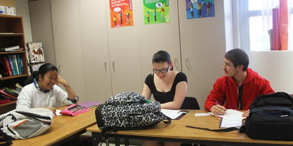 Three of Fairmonts ESOL (English as secord or other language) students, Pompan Mongkonist, Rebecca MacDonald, and Zaid Ismael converse during their class. Photo Credit: Jilly Hall