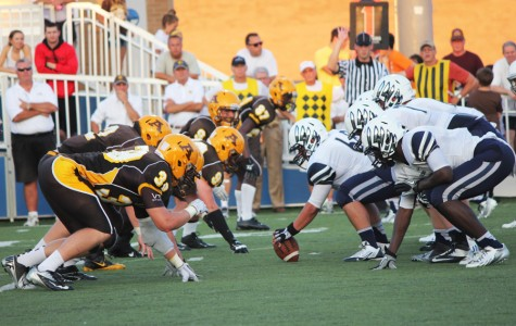 Fairmont's offense awaits the snap at the line of scrimmage during a recent Fairmont vs. Alter game.