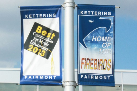 The Fairmont parking lots display Firebird achievements in hopes of appealing to prospective students.