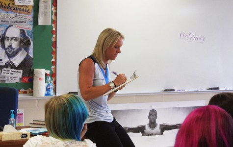 New English teacher Lacy Romine takes attendance on her first day teaching at Fairmont.