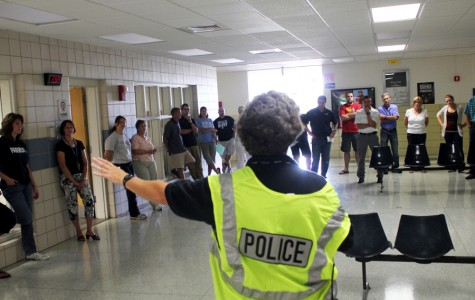 Kettering Police Officer Carla Sacher offers security advice to the teachers of West Unit during the A.L.I.C.E. training session on Aug. 30, 2013.