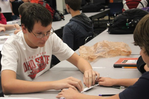 Sophomore Connor Secrest tests designs of a cotton ball launcher in Intro to Engineering and Design 1.