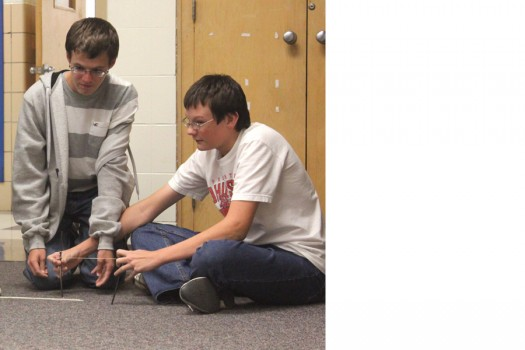 Connor Secrest and Colin Gohmann test their cotton ball slingshot in Intro to Engineering and Design 1.
