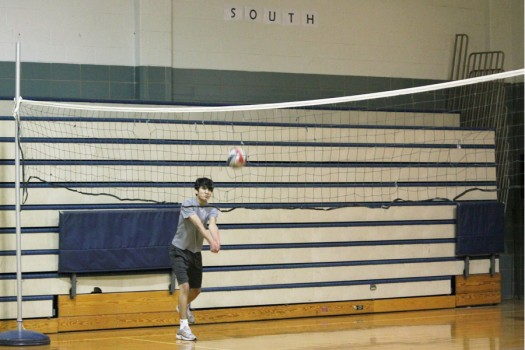Sophomore Kieran McCarthy prepares to set the volleyball as it comes his way.