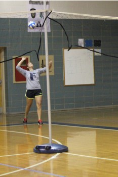 Sophomore Leah Teserovitch looks up to serve the ball to the opposing team.