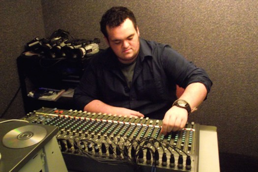 Senior Jesse Leach operates the soundboard in Interactive Media's control room.