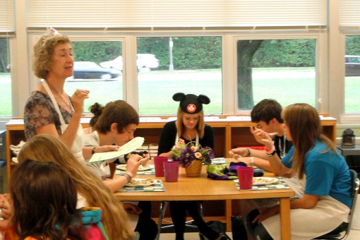 Students eating pasta salads as Mrs. Rhoades explains what kinds of pasta salads they are eating.