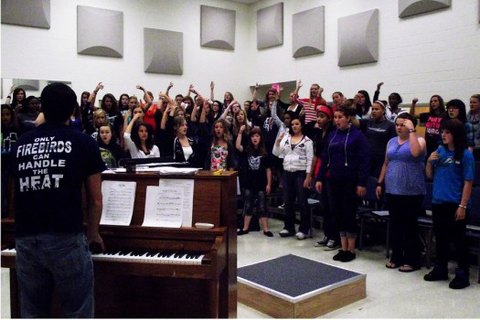 Mr. Koehler instructs the women's chorus in preparation for the holiday concert.