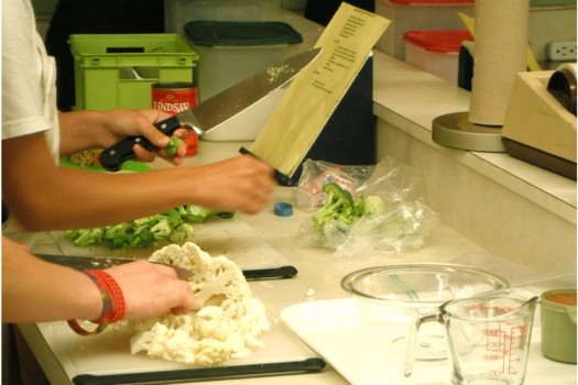 Students of Mrs. Rhoades cooking class cut up broccoli and cauliflower for pasta salads.