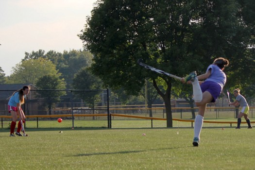 Juniors Paige Johnson and Courtney Carpenter practice drives at field hockey practice.