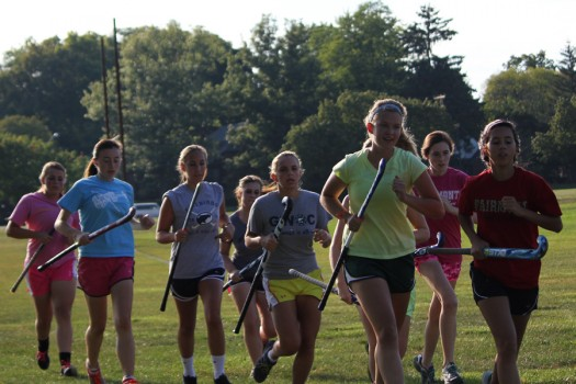 The Fairmont Varsity Field Hockey team completes an Indian run at the beginning of practice.