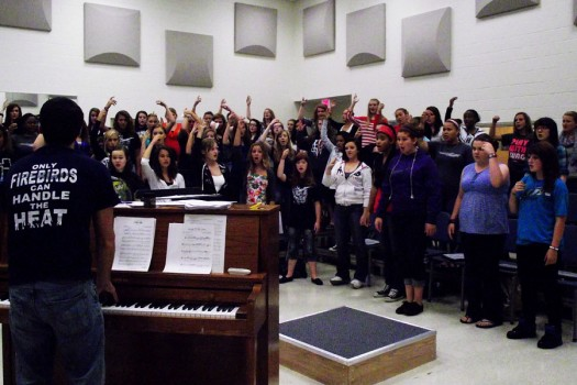 Mr.+Koehler+instructs+the+women%27s+chorus+in+preparation+for+the+holiday+concert