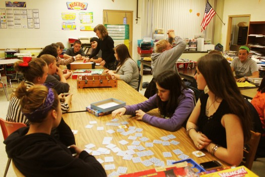Students enjoy card and board games at the Buddy System's Game Night on Nov. 5, 2013.