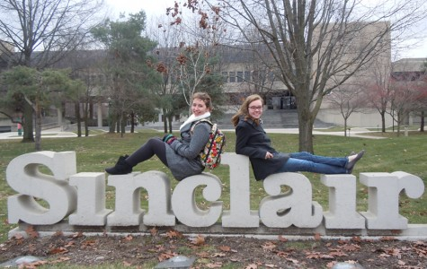 Fairmont juniors Alexis Reed (left) and Alyssa Pestian pose outside Sinclair Community College, where they attend classes as PSEO students. Reed raves about her Sinclair experience.