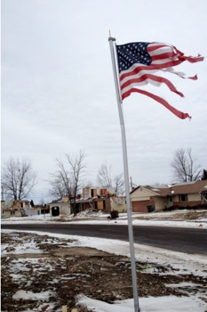 A+tattered+American+flag+sways+in+the+wind+in+front+of+the+wreckage+that+used+to+be+a+suburban+neighborhood+in+Washington+Illinois