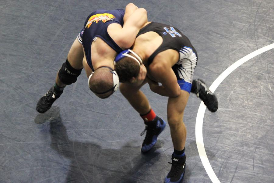 Senior Josh Parrett works to break free from his Xenia opponent at GWOC. Parrett went on to win his match.