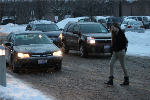Junior Quinne Hinderliter braves the morning cold as she walks across Fairmont High School's frozen parking lot.