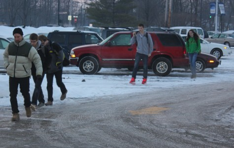 Fairmont High School students walk into school from the Performing Arts Center parking lot on a blustery February morning. Students and staff have been bearing the bitter cold, snow and ice during this difficult winter.