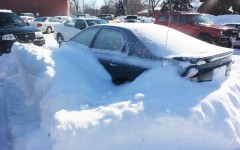 A seemingly abandoned car has been sitting idle in the Athletic Parking Lot for weeks. Snowplow operators have had to work around the car as they try to get Fairmonts lots ready for school.