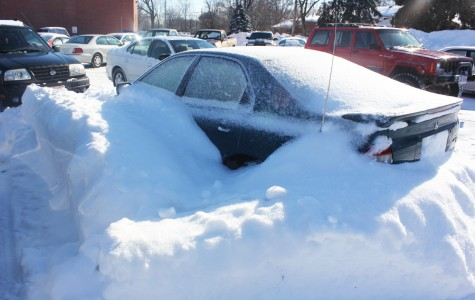 A seemingly abandoned car has been sitting idle in the Athletic Parking Lot for weeks. Snowplow operators have had to work around the car as they try to get Fairmont's lots ready for school.