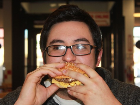 Brad Steel chows down on a burger. It was a tough assignment but The Flyer editor-in-chief agreed to try to find the best burger and fries in the Kettering area.