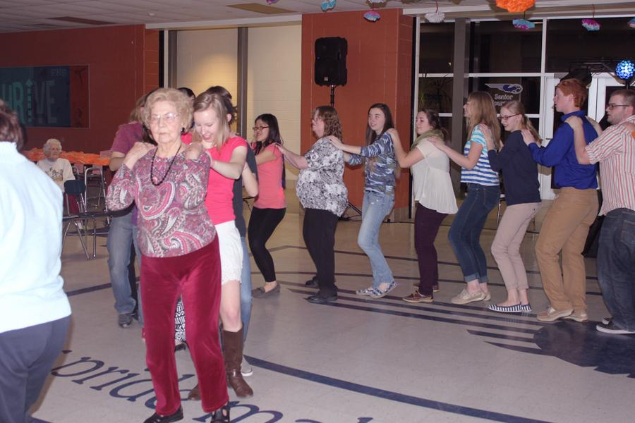 Seniors from Fairmont High School and around the Kettering community gather for a night of fun during the Seniors Helping Seniors Dance on Thursday, March 6.