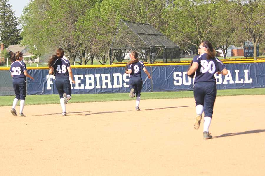 Part of the team runs to field as the game starts.