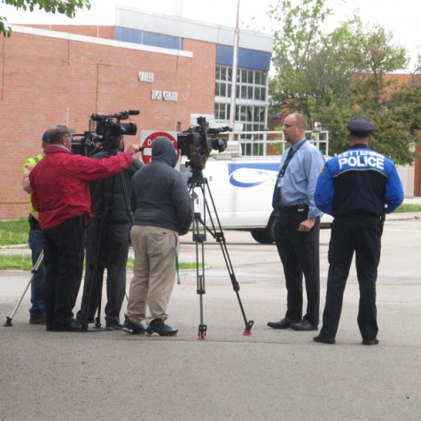 Fairmont Principal Dan VonHandorf and a representative from the Kettering Police Department are interviewed by the media because of the bomb threat at the high school. (Photo by Sam Barton)