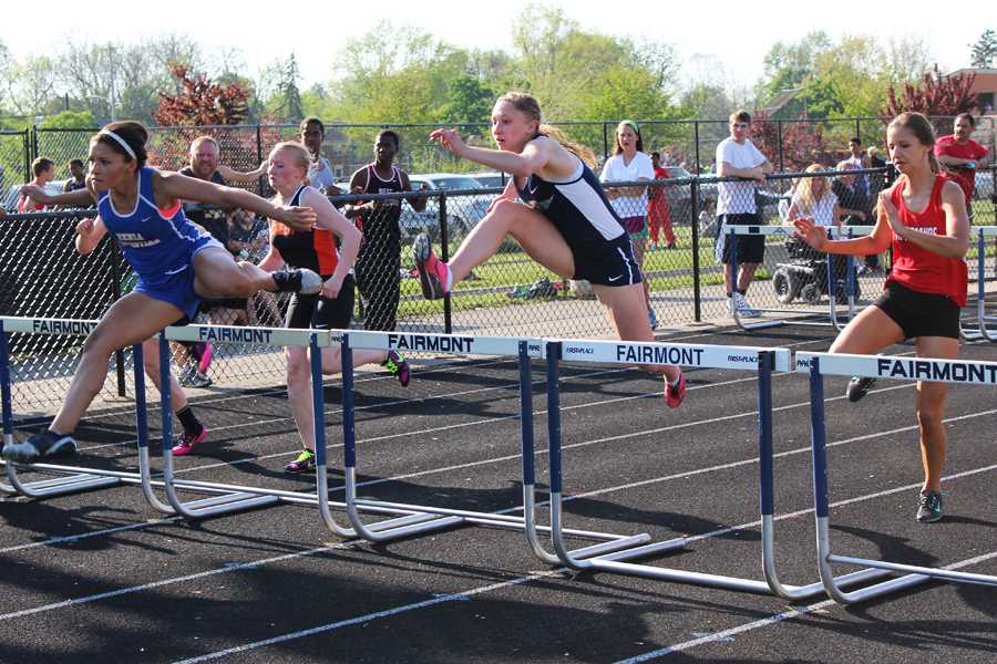 Junior Evan Bartlett runs the 100 meter hurdles at the Firebird Invitational.