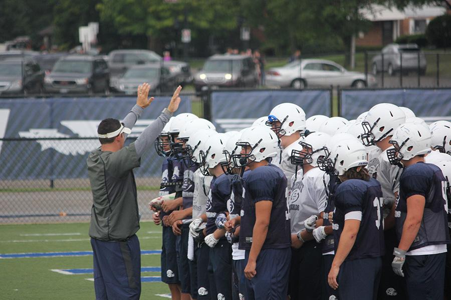 Head Football Coach Andy Aracri explains a drill to his players during practice. The Firebirds have been gearing up to take on their crosstown rivals, the Alter Knights, on Aug. 29.