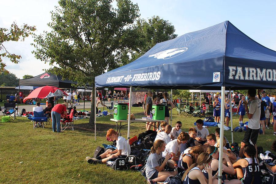 Fairmont's Cross Country team sitting together before the Saturday Night Lights meet at Centerville High School