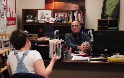 Counseling Department Chair David Elliott chats with senior Dani Carrington about schedule changes and conflicts early in the year.