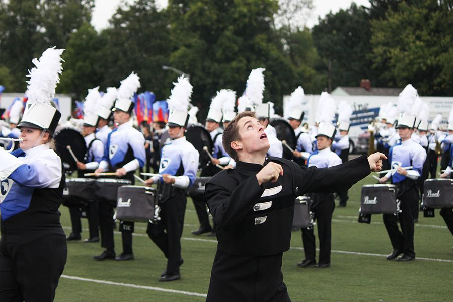 Ty Nichols, Fairmont's drum major, twirls his baton to the crowd's approval during a pregame performance.