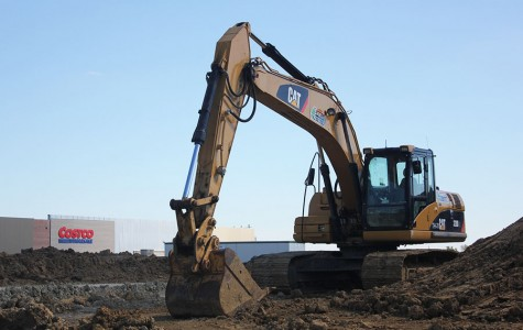 Large construction equipment and piles of dirt dominate the site where a new Costco store is under construction. Many in the community have expressed dismay that so many trees were sacrificed to make way for the warehouse store that will open in November.