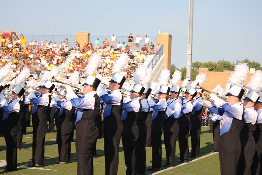 The Fairmont Marching Firebirds get the crowd motivated before the game.