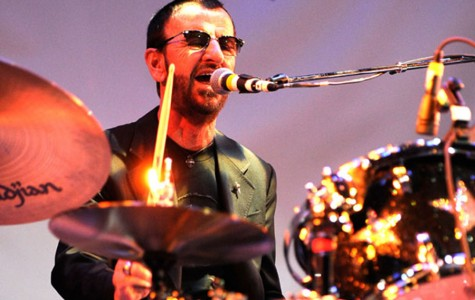 Ringo Starr does a variety of things while on stage, including playing the piano, singing, and playing the drums.