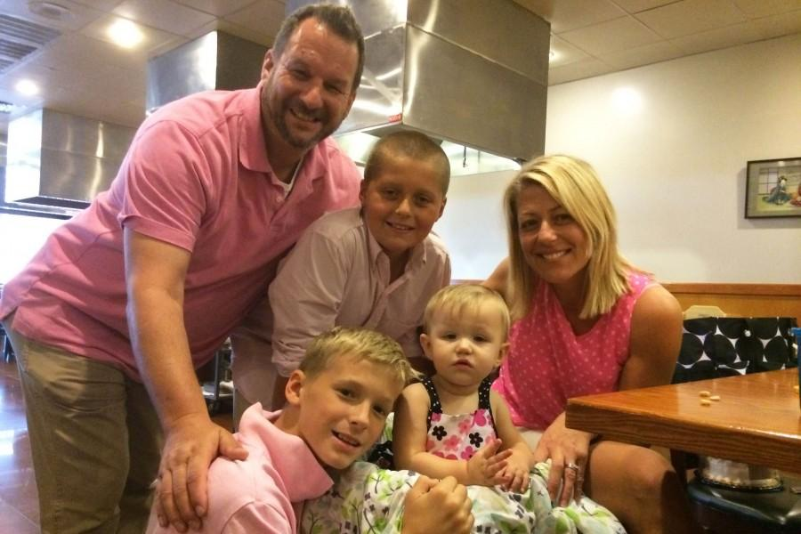 Bill Buirley, his 11-year old stepson Max, his 11-year-old son Aidan, and his wife Shannon celebrate his daughter Piper's first birthday. Buirley's oldest son, Tristan, attends Kent State University.