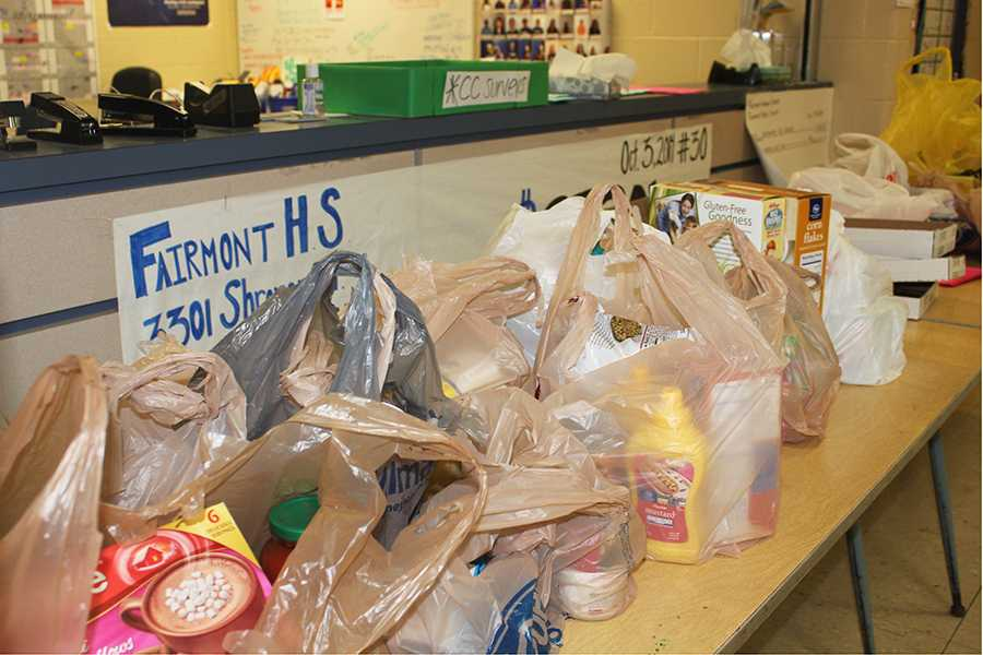 Food+piles+up+from+students+ready+to+donate+to+the+food+pantry.+