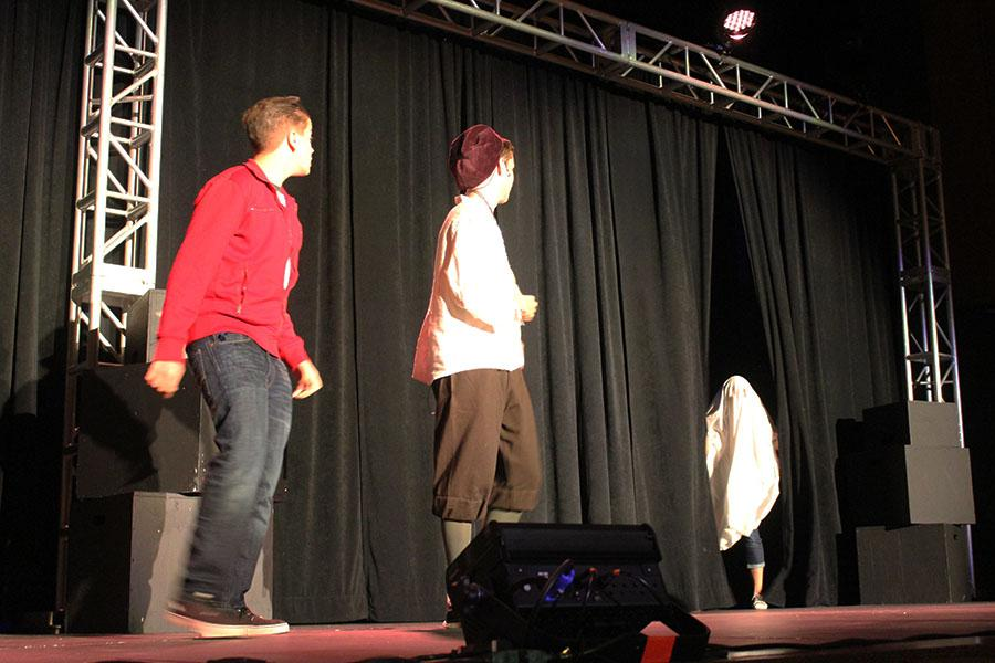 Sam Gyenes and Jamie Cunningham reenact a scene from Hamlet from which a ghost pops out at the audience.
