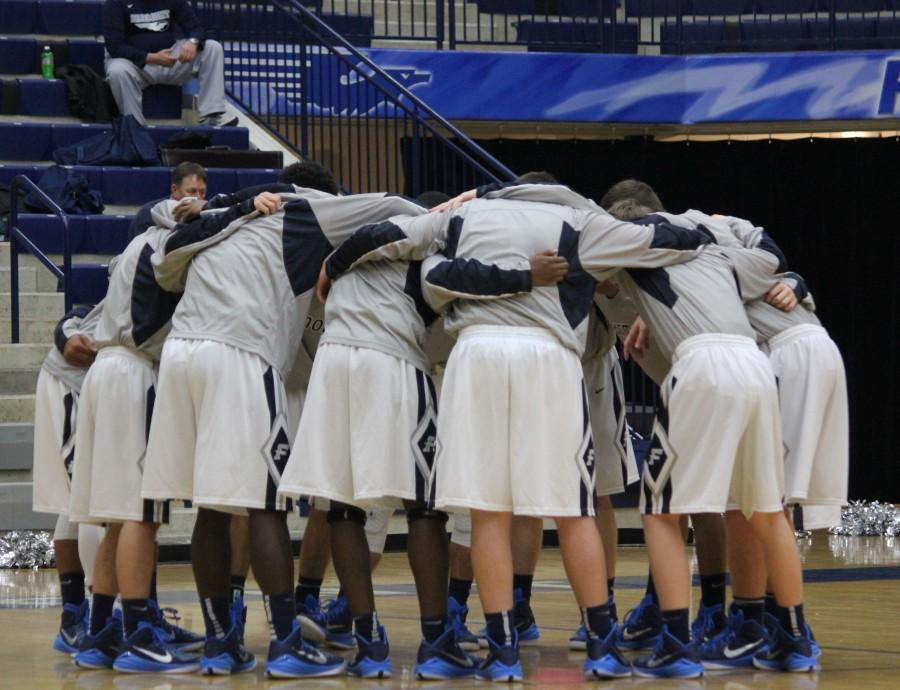 Fairmont%27s+Varsity+Boys%27+Basketball+Team+huddles+before+their+game+against+Graham+High+School.+The+boys+are+having+a+great+season%2C+with+a+record+of+14-2.