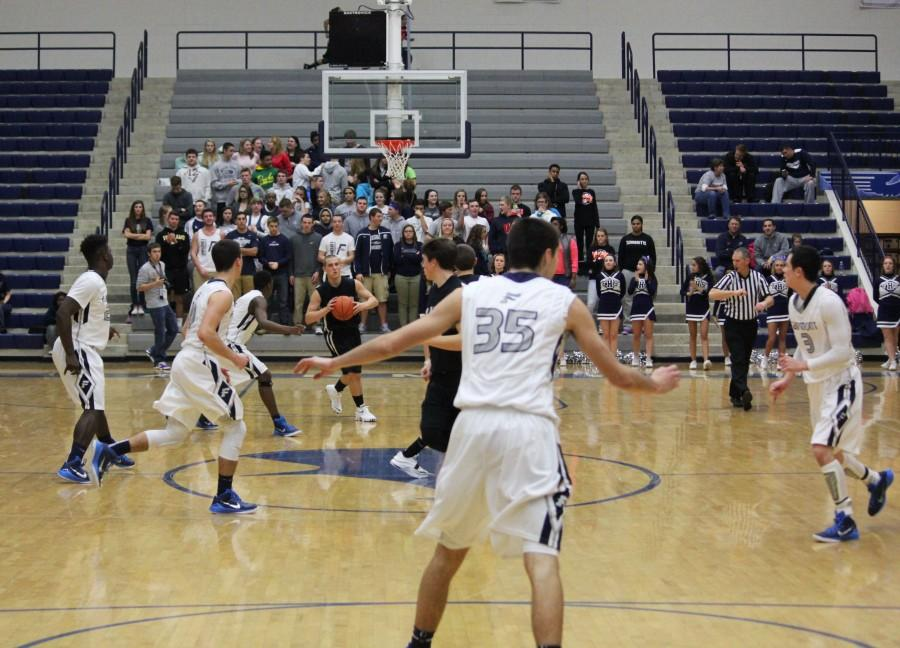 Jacob Maloney and the rest of the Firebirds play defense against Graham.
