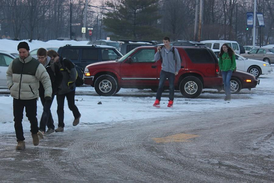 Fairmont students brave the snow and cold as they walk into school. The district has canceled school five times, so any more cancellations will result in additional days at the end of the school year.