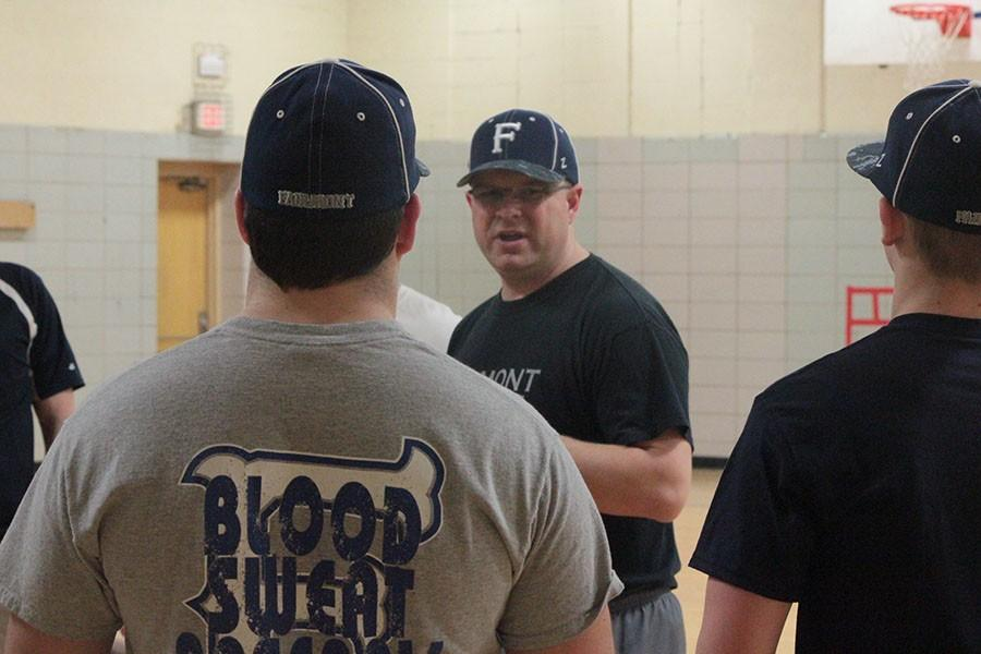 Firebird Varsity Baseball Coach Kent Drake talks to his team before they start practice in March. During spring break, the team traveled to South Carolina, where the boys captured the 2015 Forest Acres Classic championship.