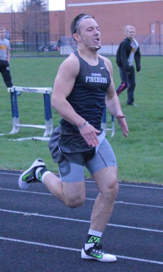 Zach Martinek strides his way  along the track.