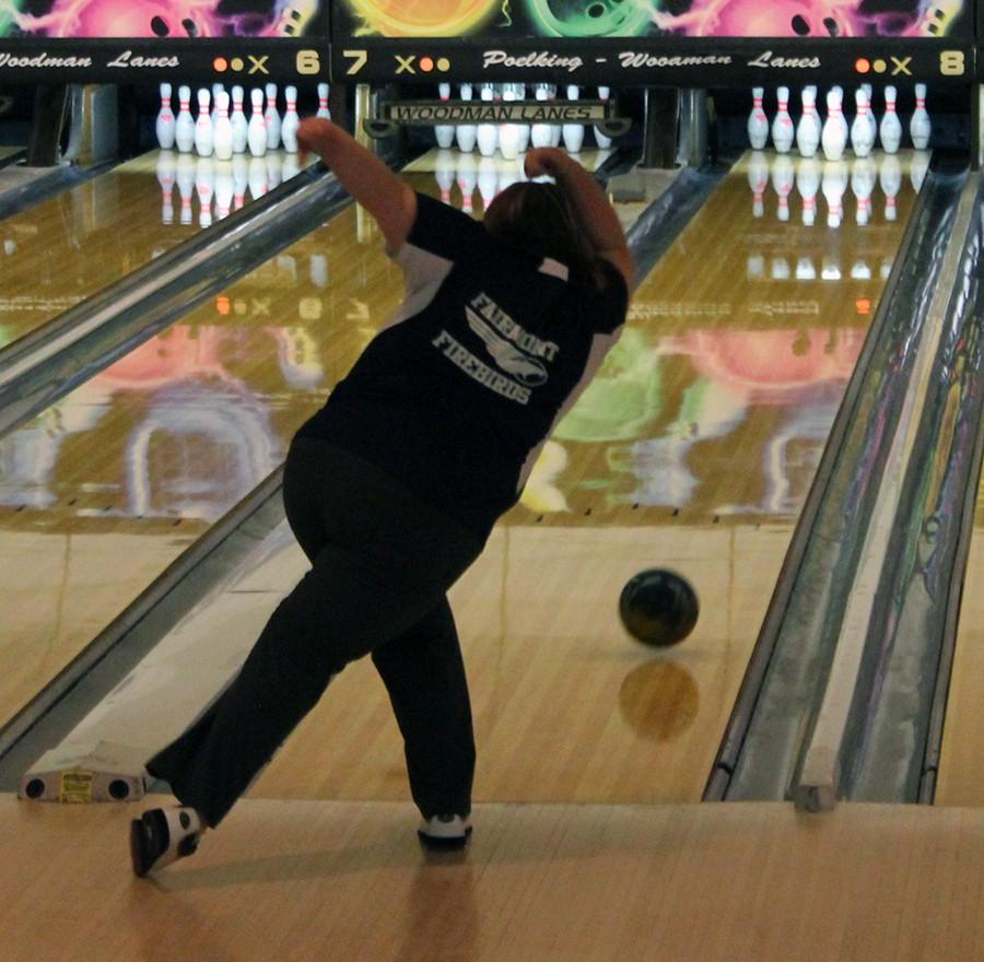 Senior captain Jessica Wolfe starts the match will a hard bowl down the lane.